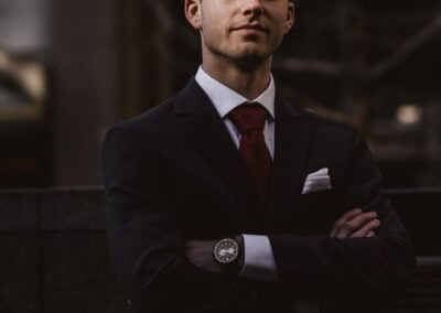 A man in a business suit with his arms folded