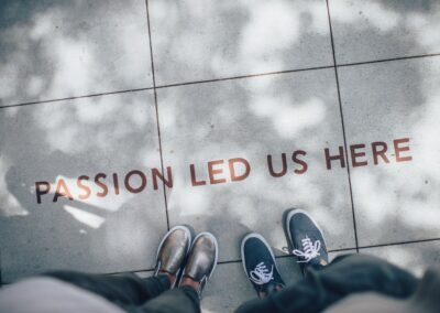 """two people looking down at their feet on pavers with the caption of, """"Passion led us here."""""""